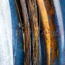 Detail of wires from tyre on burnt out wheel