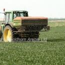 Fertiliser spreader applying nitrogen to wheat in spring at GS 31, first node