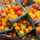 Tomatoes multiple colours at point of sale in a market,