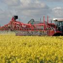 Self propelled sprayer applying fungicide in flowering oilseed rape crop