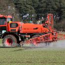 Self propelled sprayer applying fungicide and trace elements  to  winter barley crop in march